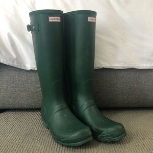 Tall dark green hunter rain boots